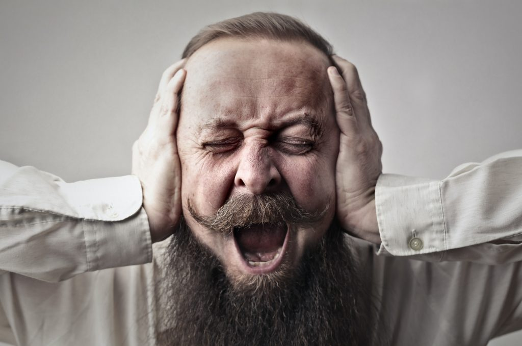 man with beard covering ears